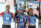 17th March 2019, Ostersund, Sweden; IBU World Championships Biathlon, day 9, mass start men; Julian Eberhard (AUT), Dominik Windisch (ITA), Antonin Guigonnat (FRA) celebrate