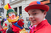 Covent Garden, London, UK. 11 May 2014. The festival starts with a procession around the streets of Covent Garden.  A young puppeteer with Mr Punch. The Covent Garden May Fayre and Puppet Festival takes place at St Paul's Church.