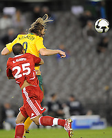 MELBOURNE, AUSTRALIA - OCTOBER 14: Joshua Kennedy from Australia heads the ball in a AFC Asian Cup 2011 match between Australia and Oman at Etihad Stadium on October 14, 2009 in Melbourne, Australia. Photo Sydney Low www.syd-low.com