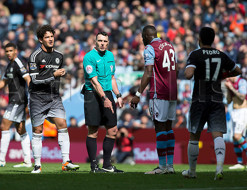 02.04.2016. Villa Park, Birmingham, England. Barclays Premier League. Aston Villa versus Chelsea.  Aston Villa defender Aly Cissokho complains to Referee Mr. Neil Swarbrick after he receives a yellow card for fouling Chelsea striker Alexandre Pato in the goal area leading to a penalty.