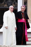 Papa Francesco, affiancato da monsignor Georg Gaenswein, al termine dell'udienza generale del mercoledi' in Piazza San Pietro, Citta' del Vaticano, 24 settembre 2014.<br /> Pope Francis, flanked by monsignor Georg Gaenswein, leaves at the end of his weekly general audience in St. Peter's Square at the Vatican, 24 September 2014.<br /> UPDATE IMAGES PRESS/Isabella Bonotto<br /> <br /> STRICTLY ONLY FOR EDITORIAL USE