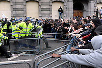 Policemen push back demonstrators outside the Bank of England as thousands of protestors descended on the City of London ahead of the G20 summit of world leaders to express anger at the economic crisis, which many blame on the excesses of capitalism.