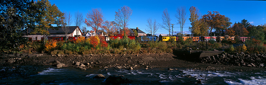 Restored trains of the Merrimack Valley Railroad, line the Winnipeasukee River in Tilton, New Hampshire. Photograph by Peter E, Randall