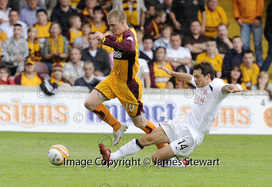 16/08/2008  Copyright Pic: James Stewart.File Name : sct_jspa20_motherwell_v_aberdeen.DEREK YOUNG GETS A YELLOW CARD FOR THIS LATE CHALLENGE ON DAVID CLARKSON.James Stewart Photo Agency 19 Carronlea Drive, Falkirk. FK2 8DN      Vat Reg No. 607 6932 25.Studio      : +44 (0)1324 611191 .Mobile      : +44 (0)7721 416997.E-mail  :  jim@jspa.co.uk.If you require further information then contact Jim Stewart on any of the numbers above........