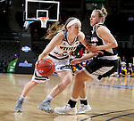 SIOUX FALLS, SD: MARCH 6: Michelle Farrow #22 from Western Illinois drives against Remy Davenport #33 from Omaha during the Summit League Basketball Championship on March 6, 2017 at the Denny Sanford Premier Center in Sioux Falls, SD. (Photo by Dave Eggen/Inertia)
