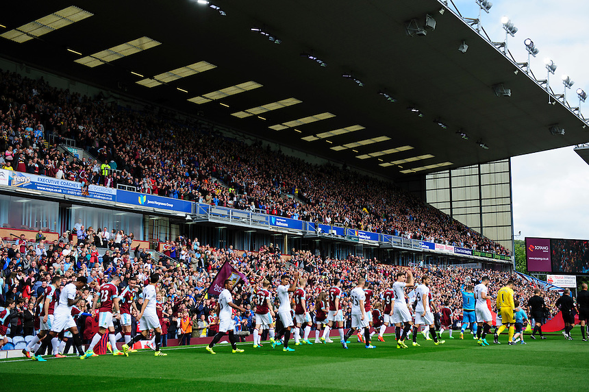 The Burnley and Swansea City players make their way out on to the pitch ahead of their first Premier League game of the season<br /> <br /> Photographer Chris Vaughan/CameraSport<br /> <br /> Football - The Premier League - Burnley v Swansea City - Saturday 13th August 2016 - Turf Moor - Burnley<br /> <br /> World Copyright &copy; 2016 CameraSport. All rights reserved. 43 Linden Ave. Countesthorpe. Leicester. England. LE8 5PG - Tel: +44 (0) 116 277 4147 - admin@camerasport.com - www.camerasport.com