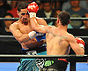 Danny Garcia, left, takes a blow from Brooklyn native Paulie Malignaggi in the main event during a 12-round Premier Boxing Champions match at the Barclays Center on Saturday, August 1, 2015. Garcia won the bout by TKO in the ninth round. <br /> <br /> James Escher