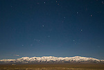 Toyabe Range with snow, night, constellation Orion, Smoky Valley, Nev.