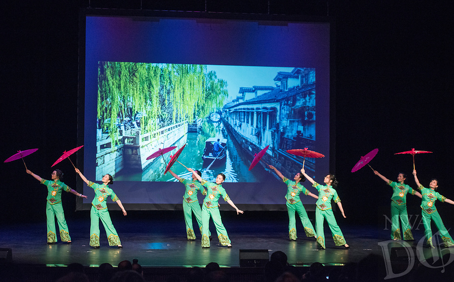 NWA Democrat-Gazette/BEN GOFF @NWABENGOFF<br /> Dancers perform a Chinese umbrella dance Saturday, Feb. 10, 2018, during the Chinese New Year Gala presented by the Chinese Association of Northwest Arkansas at Springdale Har-Ber High. The event celebrated the Year of the Dog with a dinner and a show featuring traditional and contemporary Chinese dance, music, fashion and more.