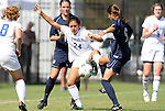 11 September 2011: Duke's Mollie Pathman (24) is defended by UNCG's Kristin Player (9) and Lauren Hein (behind). The Duke University Blue Devils defeated the University of North Carolina at Greensboro Spartans 2-0 at Koskinen Stadium in Durham, North Carolina in an NCAA Division I Women's Soccer game.