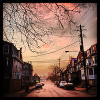 Brief morning glow and a bit of mist hang over Cherokee Street in Germantown on the morning of January 30, 2013.