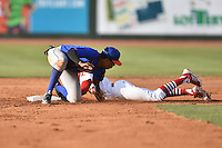 Kingsport Mets shortstop Milton Ramos (2) fields and applies the tag as DeAndre Asbury-Heath (5) slides in safely during a game against the  Johnson City Cardinals on June 25, 2015 in Johnson City, Tennessee. The Mets defeated the Cardinals 10-8 (Tony Farlow/Four Seam Images)