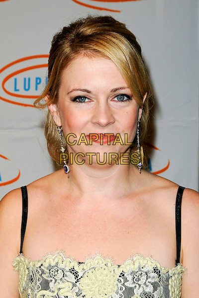 MELISSA JOAN HART.Lupus LA's 7th Annual Bag Ladies Luncheon to raise funds for lupus research at the Beverly Wilshire Four Seasons Hotel in Beverly Hills, California, USA..November 18th, 2009.headshot portrait pale yellow lace cream black hair up dangly earrings .CAP/ROT.©Lee Roth/Capital Pictures