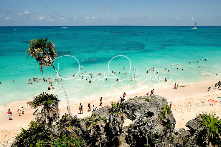 Beautiful beach and aqua water at the Mayan city Tulum near Cancun, Mexico. The archaeological site is considered one of the best-preserved coastal Maya sites. The site is popular with tourists because of its proximity to the many Mexican Riviera resorts and its picturesque view of the Caribbean Sea (shown here).