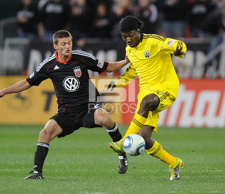 Columbus Crew forward Andres Mendoza (10)  shields the ball against DC United defender Perry Kitchen (23)     DC United defeated The Columbus Crew  3-1 at the home season opener, at RFK Stadium, Saturday March 19, 2011.