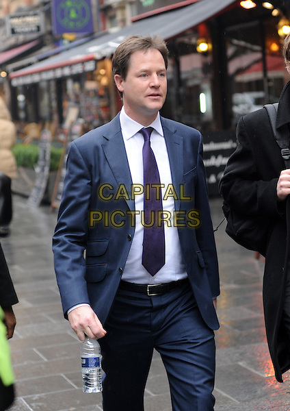 Nick Clegg.leaving Capital FM Radio, London, England..March 7th, 2013.half length blue suit white shirt purple tie bottle water .CAP/AOU.©AOU/Capital Pictures.