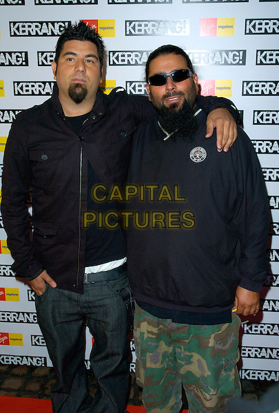 THE DEFTONES.The Kerrang! Awards 2007, The Brewery, London, England..August 23rd, 2007.half 3/4 length jeans denim jacket goatee facial hair black camouflage shorts sunglasses shades beard arm over shoulder .CAP/CAN.©Can Nguyen/Capital Pictures