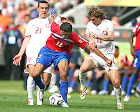 Ireneusz Jelen (21) and Miroslav Szymkowiak (10) of Poland stop Leonardo Gonzalez (12) of Costa Rica. Poland defeated Costa Rica 2-1 in their FIFA World Cup Group A match at FIFA World Cup Stadium, Hanover, Germany, June 20, 2006.