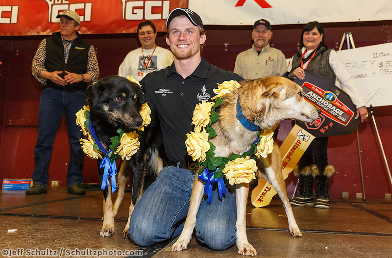 Dallas Seavey and his lead dogs Beatle and Reef pose for photos at the musher 's finishers banquet in Nome on Sunday March 16 after the 2014 Iditarod Sled Dog Race.<br /> <br /> PHOTO (c) BY JEFF SCHULTZ/IditarodPhotos.com -- REPRODUCTION PROHIBITED WITHOUT PERMISSION