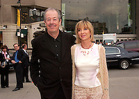 May 5, 2003 File Photo, Montreal, Quebec, Canada.<br /> <br /> Denys Arcand and his wife / Producer arrives  at the Montreal Premiere of Arcand latest movie LES INVASIONS BARBARES, that is currently in competition at Canne Film Festival <br />  in Montreal, Canada.