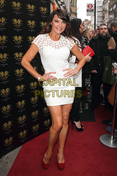 Lizzie Cundy<br /> Lipsy VIP Fashion Awards at DSTRKT, London, England.<br /> May 29th 2013<br /> full length white dress lace hands on hips red shoes <br /> CAP/ROS<br /> &copy;Steve Ross/Capital Pictures