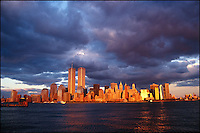 World Trade Center at sunset with dramatic storm clouds.<br />