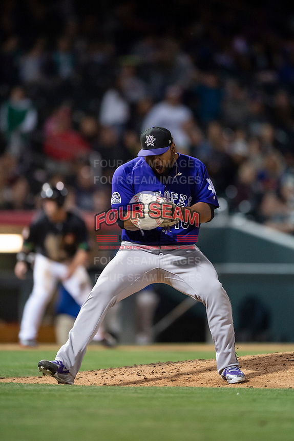 Albuquerque Isotopes relief pitcher Jairo Diaz (18) celebrates after striking out the last batter of the game to pick up his fifth save of the season during a Pacific Coast League game against the El Paso Chihuahuas at Southwest University Park on May 10, 2019 in El Paso, Texas. Albuquerque defeated El Paso 2-1. (Zachary Lucy/Four Seam Images)