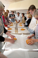 How to make foie gras duck's liver (series of images): In the work shop, each participant has an entire duck liver and a filleting knife. Preparing to start. Ferme de Biorne duck and fowl farm Dordogne France Workshop on how to make foie gras duck liver pate and other conserves
