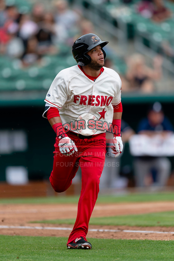 Fresno Grizzlies outfielder Yadiel Hernandez (13) watches the ball fly over the right field wall after hitting a home run during a game against the Reno Aces at Chukchansi Park on April 8, 2019 in Fresno, California. Fresno defeated Reno 7-6. (Zachary Lucy/Four Seam Images)