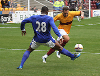 Tom Hateley beats Victor Anichebe in the Motherwell v Everton friendly match at Fir Park, Motherwell on 21.7.12 for Steven Hammell's Testimonial.