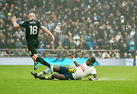 26th December 2019; Tottenham Hotspur Stadium, London, England; English Premier League Football, Tottenham Hotspur versus Brighton and Hove Albion; Moussa Sissoko of Tottenham Hotspur slide tackles Aaron Mooy of Brighton & Hove Albion - Strictly Editorial Use Only. No use with unauthorized audio, video, data, fixture lists, club/league logos or 'live' services. Online in-match use limited to 120 images, no video emulation. No use in betting, games or single club/league/player publications
