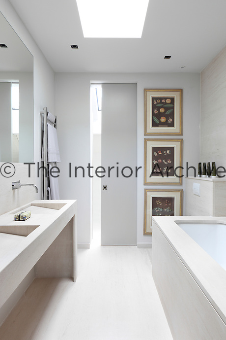 A contemporray bathroom entered via a space saving sliding door to retain a chic simplicity