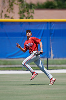 GCL Phillies West left fielder Trent Bowles (21) tracks a fly ball during a game against the GCL Blue Jays on August 7, 2018 at Bobby Mattick Complex in Dunedin, Florida.  GCL Blue Jays defeated GCL Phillies West 11-5.  (Mike Janes/Four Seam Images)