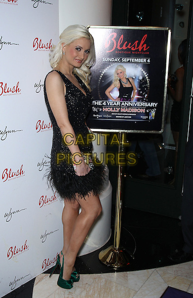 Holly Madison.Holly Madison hosts the 4th Anniversary of Blush Boutique Nightclub inside the Wynn , Las Vegas, NV., USA..September 3rd, 2011.full length black dress sleeveless sparkly  feather green shoes poster side  clutch bag roulette .CAP/ADM/MJT.© MJT/AdMedia/Capital Pictures.