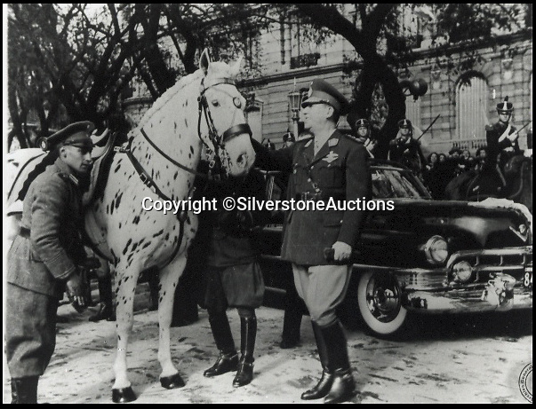BNPS.co.uk (01202 558833)<br /> Pic: SilverstoneAuctions/BNPS<br /> <br /> ***Please Use Full Byline***<br /> <br /> Former Argentine president Juan Peron.<br /> <br /> A luxury Cadillac limousine once owned by Eva Peron and her husband Juan, the former president of Argentina, has emerged for sale for 260,000 pounds.<br /> <br /> The jet black motor was used to drive Peron, known by the affectionate nickname Evita, and her husband around capital city Buenos Aires on state duties.<br /> <br /> The left-hand drive 1951 Cadillac boasts a 5.4-litre, eight cylinder engine and has a black leather bench seat in the front and a beige cloth seat in the back.<br /> <br /> Incredibly the 63-year-old car has just 3,489 miles on the clock.<br /> <br /> The car is expected to fetch 260,000 pounds when it goes under the hammer on behalf of its owner in a Silverstone Auctions sale on September 4.<br /> <br /> Also included in the sale is a jewel found inside the car when it arrived in the UK from Argentina. It is thought to have come from one of Evita's dresses.