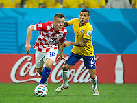 Ivica Olic of Croatia and Dani Alves of Brazil