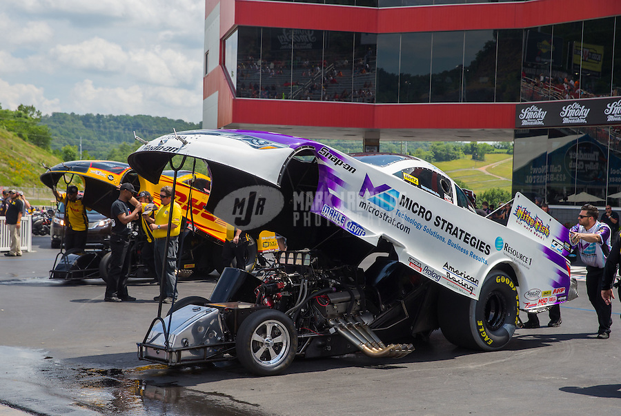 Jun 21, 2015; Bristol, TN, USA; A crew member pushing NHRA funny car driver Tony Pedregon forward during the Thunder Valley Nationals at Bristol Dragway. Mandatory Credit: Mark J. Rebilas-