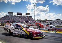 Sept. 2, 2013; Clermont, IN, USA: NHRA funny car driver Tim Wilkerson (near lane) races alongside Jack Beckman during the US Nationals at Lucas Oil Raceway. Mandatory Credit: Mark J. Rebilas-