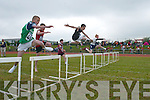 HURDLE: Daniel Shanahan (Ardfert/Kilmoyley), right, jumps the first hurdle in front of Jack McGuire (Listowel), centre, and Declan Behane (Ballydonoghue) at the Community Games County Finals at An Riocht Track, Castleisland, last Saturday..