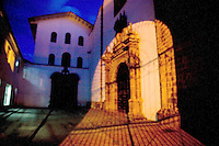 THE COURTYARD OF A CUZCO PERU CHURCH IS LIT UP FROM NEARBY STREET LIGHTS