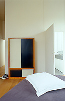 A black and white retro wardrobe stikes a note of contrast in the bedroom