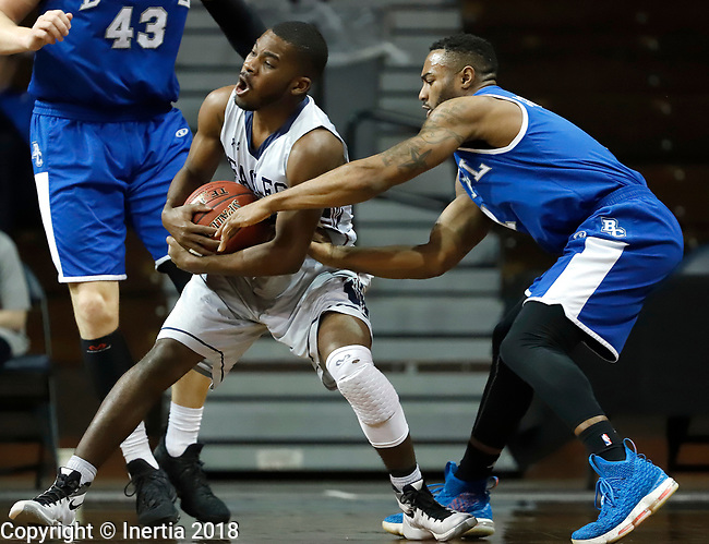SIOUX FALLS, SD - MARCH 7:  Trey'von Covington #1 from Bethel reaches for the ball as Elbert Lawrence #3 from Oklahoma Wesleyan pulls away at the 2018 NAIA DII Men's Basketball Championship at the Sanford Pentagon in Sioux Falls. (Photo by Dick Carlson/Inertia)