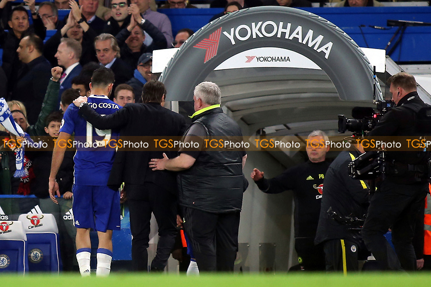 Chelsea Manager, Antonio Conte, puts his arm around Diego Costa as they walk down the players tunnel together after the match during Chelsea vs Manchester City, Premier League Football at Stamford Bridge on 5th April 2017