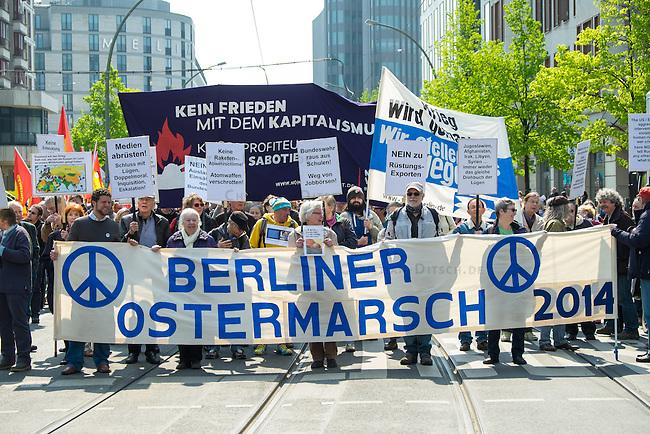 Ostermarsch 2014 in Berlin.<br />Am Samstag den 19. April 2014 fand in Berlin der traditionelle &quot;Berliner Ostermarsch&quot; fuer Frieden und gegen Ruestung statt. Mehr als 1.000 Menschen kamen zu der Friedensdemonstration, die vom Regierungsviertel zur &quot;Neuen Wache&quot; zog. Auf etlichen Plakaten und Transparenten wurde ein Ende des Buergerkrieges in Syrien, sowie ein Stopp der westlichen Intervention in der Ukraine gefordert. Ebenfalls wurde sich gegen die Entwicklung und Anschaffung von Aufklaerungs- und Kampf-Drohnen fuer die Bundeswehr sowie ein Ende der Bundeswehr-Werbung an Schulen und in Arbeitsaemtern ausgesprochen.<br />19.4.2014, Berlin<br />Copyright: Christian-Ditsch.de<br />[Inhaltsveraendernde Manipulation des Fotos nur nach ausdruecklicher Genehmigung des Fotografen. Vereinbarungen ueber Abtretung von Persoenlichkeitsrechten/Model Release der abgebildeten Person/Personen liegen nicht vor. NO MODEL RELEASE! Don't publish without copyright Christian-Ditsch.de, Veroeffentlichung nur mit Fotografennennung, sowie gegen Honorar, MwSt. und Beleg. Konto: I N G - D i B a, IBAN DE58500105175400192269, BIC INGDDEFFXXX, Kontakt: post@christian-ditsch.de]
