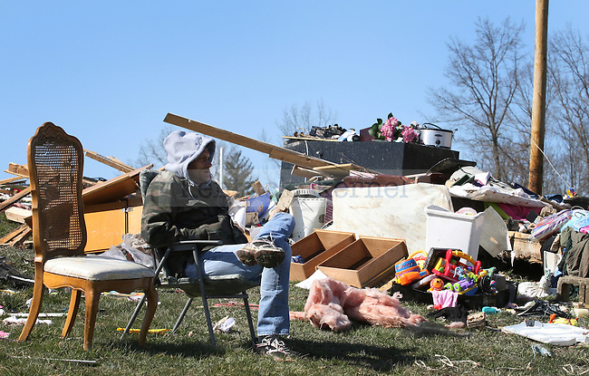 Residents of East Bernstadt in Laurel County, Ky. returned to pick up belongings on March 3, following the March 2, 2012 tornado in which five people in the county were killed. Photo by Latara Appleby | Staff .