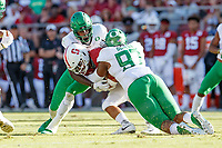 STANFORD, CA - SEPTEMBER 21: Cameron Scarlett #22 of the Stanford Cardinal is tackled by Brandon Dorlus #97 and Bryson Young #56 of the Oregon Ducks during a game between University of Oregon and Stanford Football at Stanford Stadium on September 21, 2019 in Stanford, California.