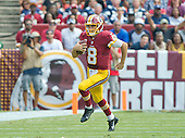 Washington Redskins quarterback Kirk Cousins (8) carries the ball for a first down in second quarter action against the Dallas Cowboys at FedEx Field in Landover, Maryland on Sunday, September 18, 2016.<br /> Credit: Ron Sachs / CNP