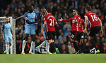 Ander Herrera of Manchester United of reacts after a tackled by Fernandinho and Yaya Toure of Manchester City during the English Premier League match at The Etihad Stadium, Manchester. Picture date: April 27th, 2016. Photo credit should read: Lynne Cameron/Sportimage