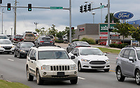 NWA Arkansas Democrat-Gazette/DAVID GOTTSCHALK Traffic moves Wednesday, September 12, 2018, through the intersection of College Avenue and Masonic Drive in Fayetteville. The city of Fayetteville is developing the 71B Corridor Plan in order to guide development along stretches of College Avenue, Archibald Yell Boulevard and South School Avenue.