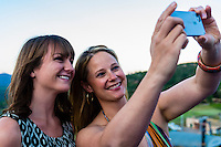 "Two young women take a ""selfie"" (self-portrait) with their camera at the Westin Snowmass Resort, Snowmass Village (Aspen), Colorado USA."